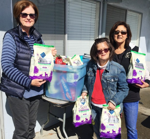 John L. Lipp/FAASRosemary Reilly, the program director for Alameda Meals on Wheels, prepares with volunteers Maddy and Marcy Pearce to distribute pet food donated by Friends of the Alameda Animal Shelter for Alameda Meals On Wheels clients.