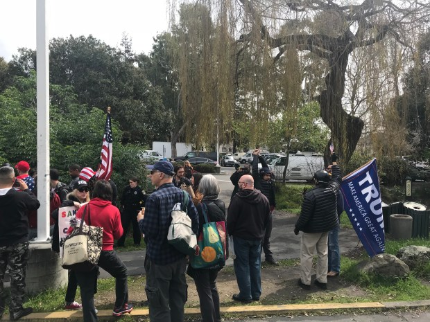 In a photo shared by Oakland mayor Libby Schaaf's office, pro-President Trump protesters gather Sunday, March 18, 2018 at the Temescal farmers market in the 5300 block of Claremont Avenue.