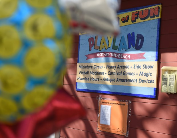 Balloons wave in front of Playland-Not-At-The-Beach and a posted notice of development application on March 17 in El Cerrito. (Courtesy of Haley Nelson)