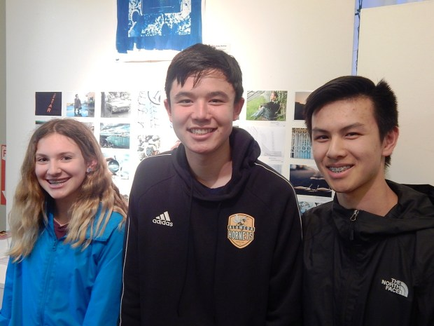"""Three participants in the Youth Division pose at the """"Alameda on Camera"""" opening reception April 6 at the Frank Bette Center for the Arts in Alameda. Shown, from left, are Ava Burton, Kennedy Chung and Kyle Wonzen. (Courtesy of Charles A. Lopez Sr.)"""