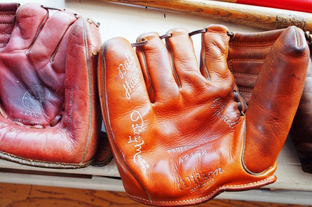 Chris Treadway/for Bay Area News GroupA left-handed Billy Martin model glove from the 1960s appears on display recently in the window of longtime Alameda collectibles shop The Silver Baron.