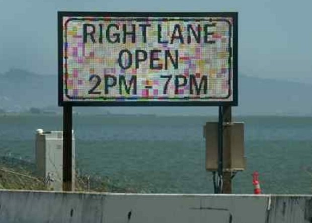 New signs on eastbound Highway 580 notify drivers that the third eastbound lane on Richmond-San Rafael Bridge is open. (Robert Tong/Marin Independent Journal)