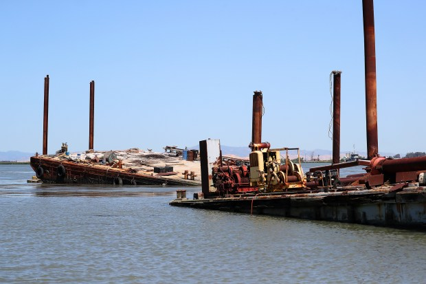 A pair of sunken barges are photographed in the waters of the Delta on Monday, June 11, 2018, in Contra Costa County, Calif. Abandoned vessels are spread throughout the Delta and the Contra Costa County Sheriff's Office hopes that pasage of AB 2441 will help provide money to remove commmerical vessels from the waterway. (Aric Crabb/Bay Area News Group)