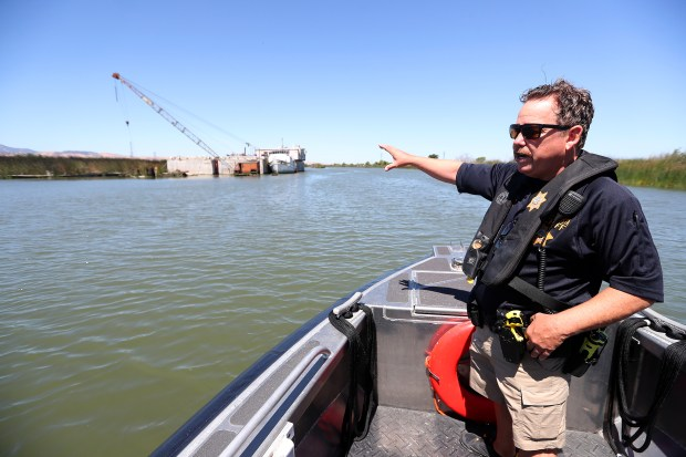 Doug Powell of the Contra Costa County Sheriff Marine Patrol Unit is photographed on the Warren E. Rupf patrol boat in the waters of the Delta on Monday, June 11, 2018, in Contra Costa County, Calif. Abandoned vessels are spread throughout the Delta and the sheriff's deparment hopes that pasage of AB 2441 will help provide money to remove commmerical vessels from the waterway. (Aric Crabb/Bay Area News Group)