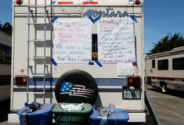 A community sign is posted on the back of an RV that neighbors say belongs to a UC Berkeley graduate in the parking lot of Hs Lordship restaurant in Berkeley, Calif., on Monday, June 11, 2018. Gonzales and her family tried everything they could to stay off the streets while battling illness. (Laura A. Oda/Bay Area News Group)