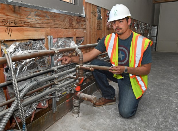 Michael Vila, with Vila Construction, is photographed next to some piping work that was installed incorrectly by a San Ramon Valley Unified School District vender, adding $5.7 million in additional cost to correct, at the Stone Valley Middle School construction site in Alamo, Calif., on Friday, June 22, 2018. Vila contends that the San Ramon Valley Unified School District has his century old construction project on the verge of bankruptcy. The school district is seeking to terminate the contract with his firm to avoid paying $5.7 million that he said is owed. (Doug Duran/Bay Area News Group)