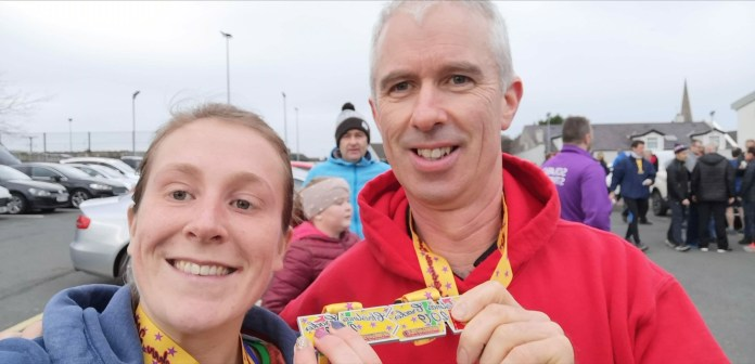 Halle Jennings and Eamon Kelly East Down AC showing off their finishers medals on Saturday