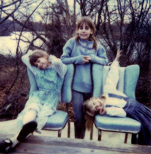 Three kids play house by the river.