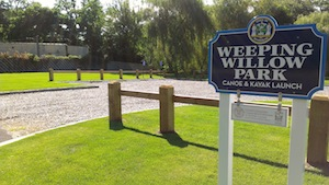 Government people in suits will have a ceremony to open the Weeping Willow Park on West Main Street in Riverhead this Friday on the former site of a motel known throughout West Main Street for its troubled inhabitants.
