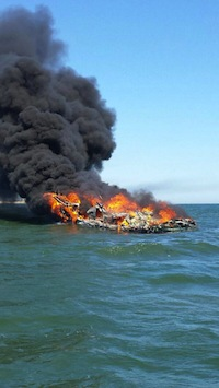 Three fishermen were rescued from their burning boat off of Shinnecock Inlet Sunday | Coast Guard photo