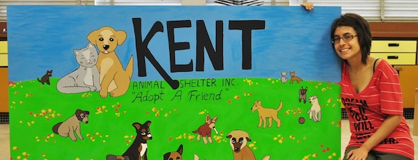 Riverhead High School award-winning artist and 2014 graduate Maria Valdivia painted two murals for the Kent Animal Shelter in Calverton, which is undergoing renovations.  Maria, who graduated 13th in her class, will be attending the New York Institute of Technology, where she plans to major in computer science and animation.