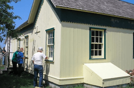 Volunteers paint the historic Trubisz House at Hallockville | Hallockville Facebook photo