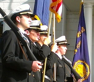 Members of the North Fork NJROTC Color Guard stand at attention.