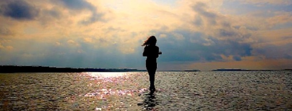 Singer-songwriter Sara Hartman walks on water.           bryan downey photo