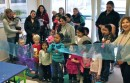Children from Riverside cut the ribbon on their new art class headquarters Tuesday evening.
