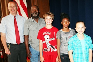 "Pulaski Principal David Densieski, Riverhead resident Robert (""Bubby"") Brown  with the Pulaski Street Juneteenth Essay Contest Winners: Danny Squires, Hydeia Russell-Irving  and Michaela Harris."