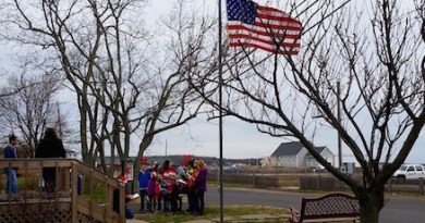 The New Suffolk School serenaded everyone at the New Suffolk Post Office with Christmas carols during Monday's gray afternoon