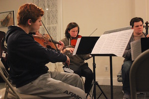 Brett Callagy, Allyson Koehler and Aidan Saltini at their Dec. 1 rehearsal.