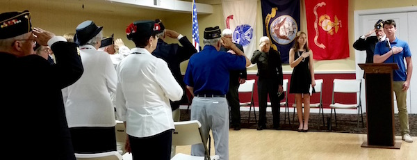 Hampton Bays High School student Christiaan Padavan sang the national anthem at the Hand Aldrich American Legion Post's annual Memorial Day service Monday, which was held inside due to inclement weather, which cancelled the Hampton Bays parade.