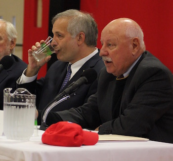 Greg Fischer takes a drink of water, Ken LaValle's hat on the table.