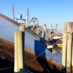 The U.S. Coast Guard and Southampton Town workers removed a sunk fishing vessel from the Shinnecock commercial dock this week.