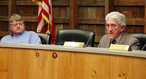 Town Supervisor Larry Cantwell (right) pledged support for immigrant rights, while Councilman Fred Overton (left) looked on.