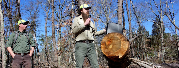 DEC foresters Nate Hudson and Rob Cole explained the work the DEC has done to prevent the spread of southern pine beetles in Hubbard County Park.