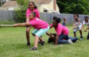 Kids, many of whom are members of the Butterfly Effect, have a tug-o-war at Saturday's Juneteenth celebration.