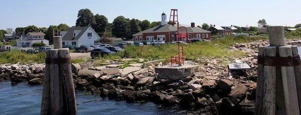 """Lea Cetera's """"Chair Totem Pole"""" at the entrance to the Fishers Island ferry dock."""