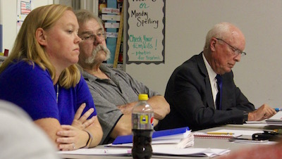 New Suffolk School Board members Jeanette Cooper, Joseph Polashock and President Tony Dill at Tuesday's school board meeting.