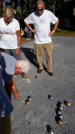 Joanne Yacko measures the balls' distance from the cochonnet at the end of a round.