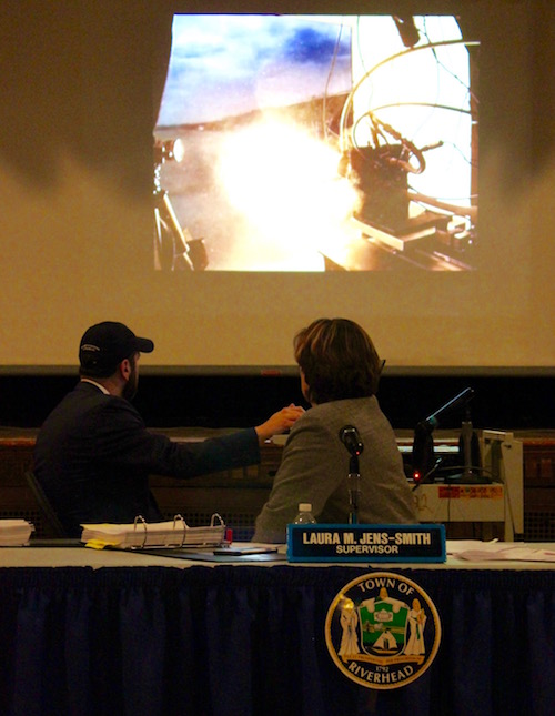 Town Supervisor Laura Jens-Smith watches a presentation on Launcher's rocket engine technology.