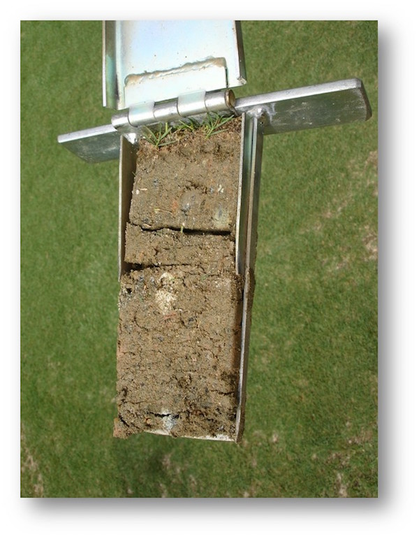 """A sample of poor soil from a golf course. Possibly a """"clean fill"""" material, this soil features many large particles and scant organic matter."""