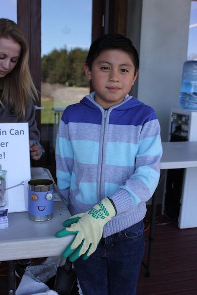 Eric Cargua, 8 makes a tin can planter at SoFo