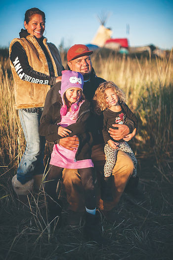 "Camille Seaman's ""Family at Oceti Sakowin camp, Standing Rock Reservation, North Dakota, 2016."""