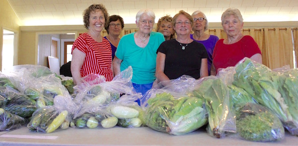 Volunteers with the Springs Food Pantry readied fresh vegetables for clients on a Wednesday in mid-July.
