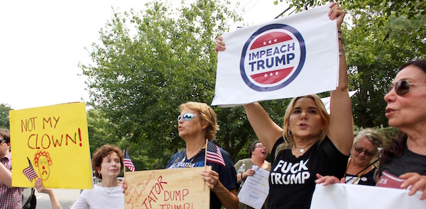 Bonnie Doyle, Janis Hurley and Judith and Helen Verno protested Donald Trump's arrival in Southampton Friday.