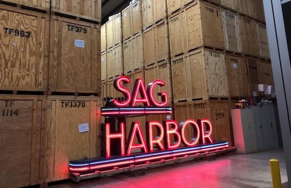 Above, the Sag Harbor sign restored! by John Battle, Clayton Orehek, and Christ Denon   Chris Denon photo courtesy Sag Harbor Partnership