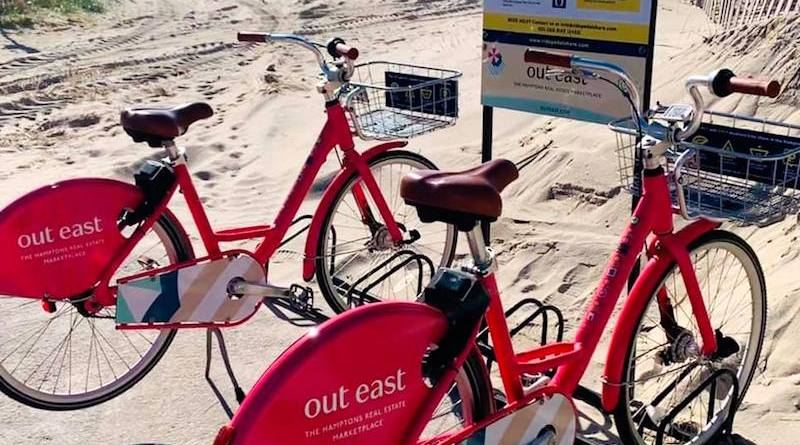 PedalShare's bikes, which are partially supported by promotional advertising, at a beach in Southampton Village.