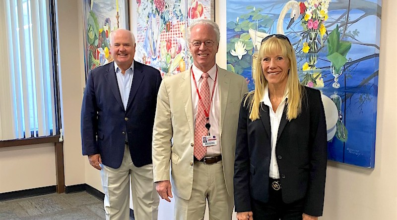 ELIH board member Terrance McLaughlin, Stony Brook ELIH CAO Paul Connor and Jacqueline Penney's daughter Deborah Penney with the paintings that have been donated to the hospital.