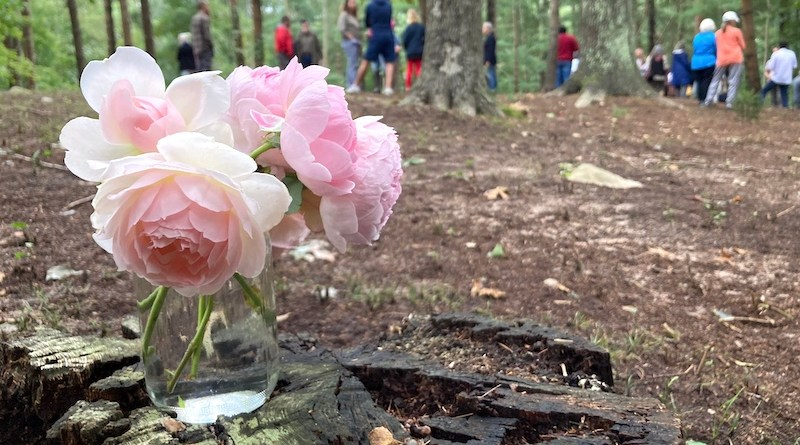 A ball jar filled with roses at a Sept. 24 ceremony to honor the Afro-Indigenous people buried at Sylvester Manor on Shelter Island.