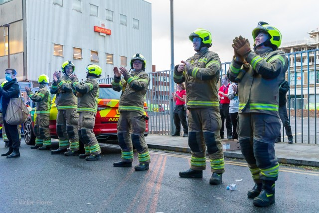 Firefighters clap for carers outside the Royal London Hospital