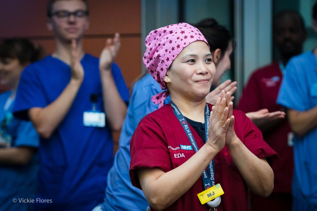 Medical staff clap for carers outside the Royal London Hospital