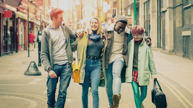 Photo of four young and trendy hipsters types in Brick Lane.