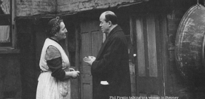 Photo of Phil Paritin talking to a woman in Stepney © Collage, London Picture Archive, City of London