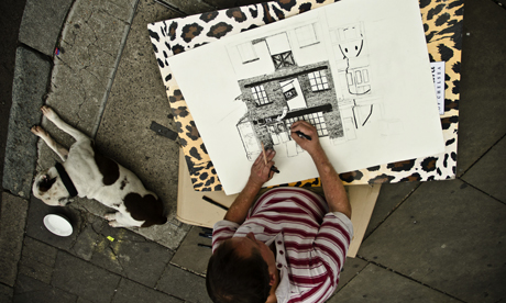 Mr Dolan drawing on a Shoreditch Street with his dog George