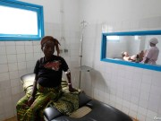 A pregnant woman waits while another goes into labour at the general hospital in Man
