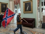 Kevin Seefried brought the Confederate flag from his home in Delaware