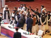 Talks start between the Afghan government and the Taliban despite the fighting
