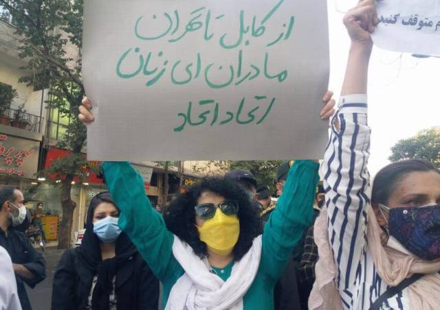 Iranian people protesting against the Taliban's occupation of Afghanistan